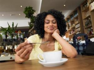 Black woman having coffee
