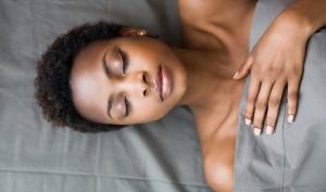 Woman Sleeping in Bed --- Image by © John-Francis Bourke/Corbis